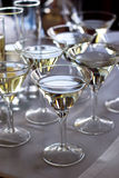 Champagne. Glasses on white table Stock Photography