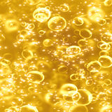 Champagne. Bubbles on a golden background Stock Image