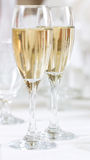 Champagne. 2 flutes with champagne. Focus on the glass at the back royalty free stock images
