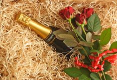 Champagne. Basket with champagne and red roses Royalty Free Stock Photos
