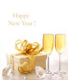Champagne. Glasses of champagne with gold ribbon gift. Happy New Year Royalty Free Stock Image
