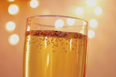 Champagne. Glass with Champagne, unsharp lights in the background Royalty Free Stock Image
