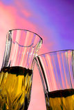Champagne. Couple of champagne cups with great sky as background royalty free stock images