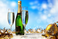 Champagne against blue background Royalty Free Stock Photography
