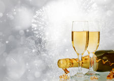 Champagne against fireworks and holiday lights Royalty Free Stock Photography