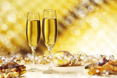 Champagne against golden background Stock Images