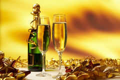 Champagne against golden background Royalty Free Stock Images