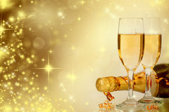 Champagne against holiday lights ang Christmas decorations Stock Photo