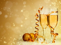 Champagne against holiday lights ang Christmas decorations Royalty Free Stock Photo