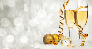 Champagne against holiday lights ang Christmas decorations Royalty Free Stock Photography