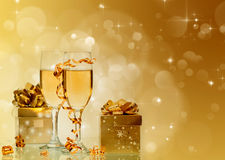 Champagne against holiday lights ang Christmas decorations Stock Image