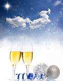 Champagne against holiday lights ang Christmas decorations Royalty Free Stock Images