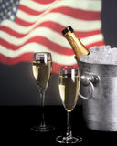 Champagne with American flag in background royalty free stock images