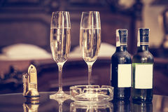Champagne and antique keys in a luxury hotel apartment Stock Image