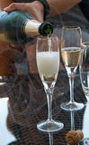 Champagne anyone?. Celebrate with friends - pouring champagne into a champagne glassn Royalty Free Stock Photos