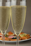 Champagne and appetizer Royalty Free Stock Images