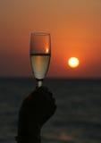 Champagne au coucher du soleil Image stock