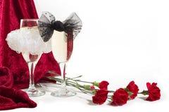 Champagne avec des noeuds de proue Images libres de droits