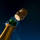 Champagne avec la vapeur de liège Photos libres de droits