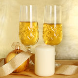Champagne ball and candle Royalty Free Stock Images