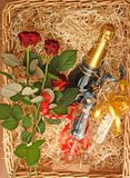 Champagne basket. Basket with champagne, glasses and red roses Stock Photo