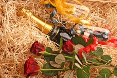 Champagne basket. Basket with champagne, glasses and red roses Stock Image