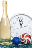 Champagne, baubles and clock face. Royalty Free Stock Photos