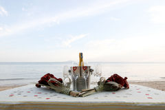 Champagne on the beach Royalty Free Stock Image