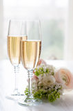 Champagne and a beautiful bouquet Stock Photography
