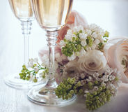 Champagne and a beautiful bouquet Royalty Free Stock Images