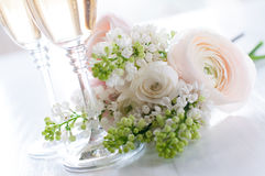 Champagne and a beautiful bouquet Royalty Free Stock Photo