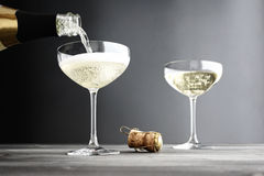 Champagne being filled in Coupe Glasses Royalty Free Stock Photography