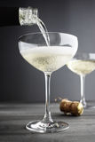 Champagne being filled in Coupe Glasses Royalty Free Stock Photos