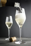 Champagne being filled into Glasses Stock Photo