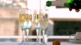 Champagne being poured into flutes Royalty Free Stock Photography