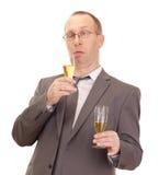 Champagne bevente della persona di affari Immagini Stock
