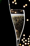 Champagne on black background. Champagne glass and bottle on black background Royalty Free Stock Photography
