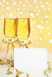 Champagne with blank invitation Stock Image