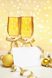 Champagne with blank invitation Stock Photo