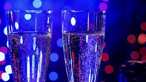 Champagne on blue background stock footage