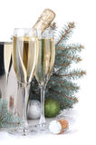 Champagne, blue firtree and christmas decor Stock Photos