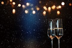Champagne with blue spotlight and golden bokeh Royalty Free Stock Image