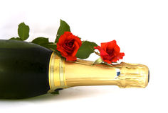 Champagne bottle. A champagne bottle with two red roses Stock Photo
