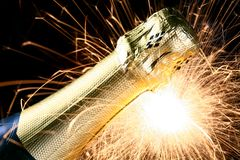 Champagne bottle. A champagne bottle with sparks Stock Photos