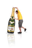 Champagne bottle. A man holding a big champagne bottle with a christmas label over a white background Royalty Free Stock Photos