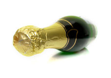 Champagne bottle. The champagne bottle lays on a white background. Isolation. Shallow DOF Stock Images