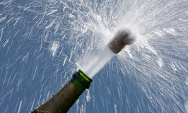 Champagne bottle. Ender corks popping open a bottle of champagne Royalty Free Stock Images