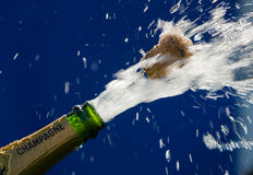 Champagne bottle. Ender corks popping open a bottle of champagne Stock Photography
