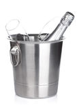 Champagne bottle in bucket and empty glasses Stock Photos