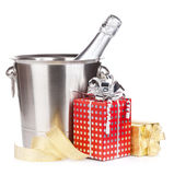 Champagne bottle in bucket and gift boxes Royalty Free Stock Photography